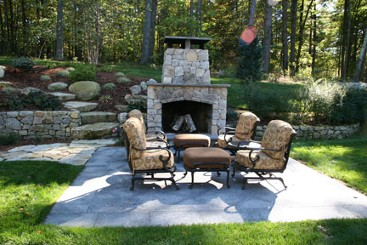 Fireplace with square opening, granite, retaining wall and natural stone steps by New View