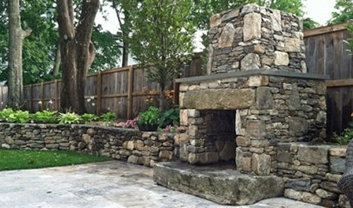 Fireplace with Granite Block, Raised Hearth and Blue Stone Mantle with Field Stone Retaining and Travertine Patio