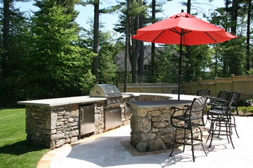 Curved Stone Bar with Built in Grill, Refrigerator, Side Burner and Trash Center by New View
