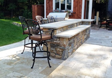 ... Bi Level Stone Bar With Blue Stone Top And Built In Grill By New View