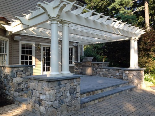 Raised Blue Stone Patio, Pergola with Stone Posts and Built in Grill by New View