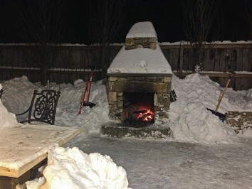 Fireplace in snow by New View