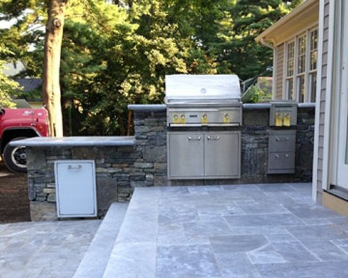 Stone Bar on Travertine Patio Steps with Built in Grill, Refrigerator and Side Burner