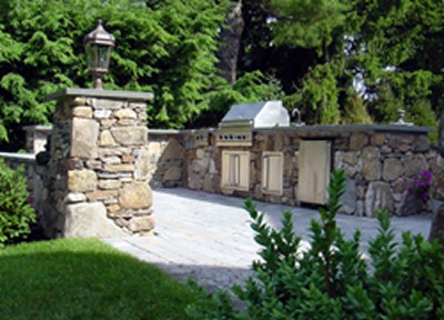 Stone Bar with Built in Grill and Stone Posts by New View