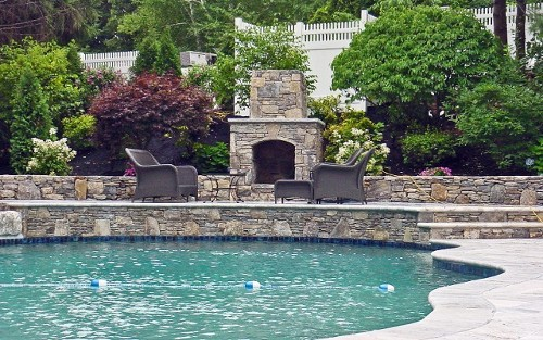 Raised Patio with Travertine Steps and Fireplace, Pool Design and Landscape by New View