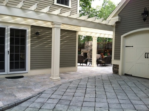 Granite and Travertine Driveway with Pergola by New View